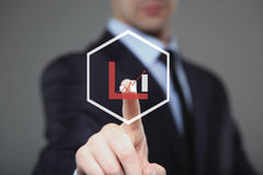 Businessman Touching a Graph Indicating Growth. Gray background Stock Photography