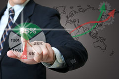 Businessman touching  graph Royalty Free Stock Images