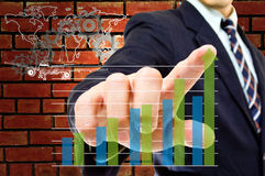Businessman touching graph Stock Photography