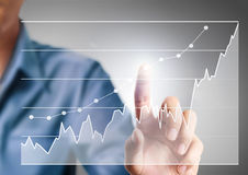 Businessman Touching graph Stock Image