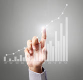 Businessman Touching graph. Of work Royalty Free Stock Image