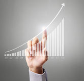 Businessman Touching graph. Of work Stock Photography