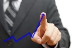 Businessman touching growing arrow. Positive trend concept Stock Photos