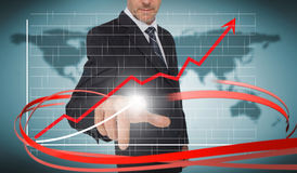 Businessman touching growth graph on futuristic interface with r Royalty Free Stock Images