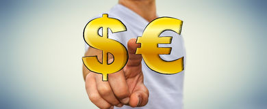 Businessman touching hand drawn dollar and euro icons Stock Photos