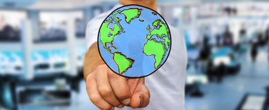 Businessman touching hand drawn planet earth Royalty Free Stock Photos