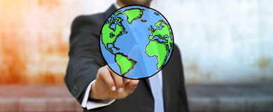 Businessman touching hand drawn planet earth Royalty Free Stock Photo