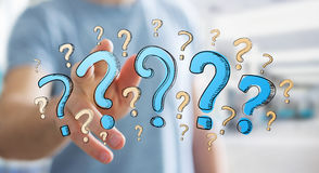 Businessman touching hand drawn question marks with his fingers Stock Photography