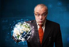 Businessman touching high-tech 3d earth panel Stock Photos