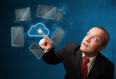 Businessman touching high technology cloud service Stock Photo