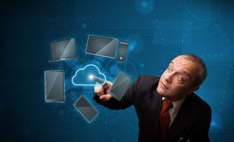 Businessman touching high technology cloud service Royalty Free Stock Photos