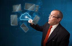 Businessman touching high technology cloud service Stock Images
