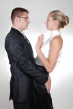 A businessman touching his secretary's back Royalty Free Stock Photo