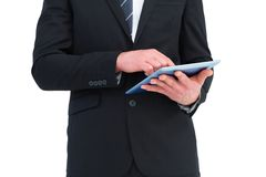 Businessman touching his tablet pc. On white background Stock Images