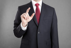 Businessman touching or holding something Royalty Free Stock Photography