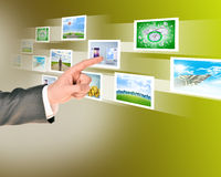 Businessman touching holographic pictures Royalty Free Stock Photo