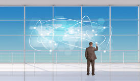Businessman touching holographic screen Royalty Free Stock Photography