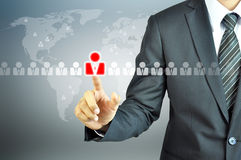 Businessman touching human sign. On virtual screen - HR,HRM,HRD ,CRM concept Royalty Free Stock Images