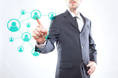 Businessman touching icons Royalty Free Stock Image