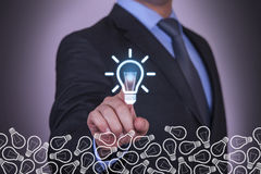 Businessman Touching Idea Blue Light Bulb Stock Photography