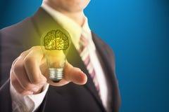 Businessman touching idea brain blub Royalty Free Stock Image