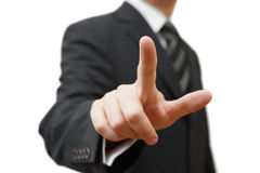 Businessman touching an imaginary screen Royalty Free Stock Photography