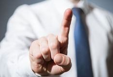 Businessman touching with index finger something Stock Photo
