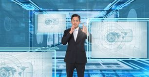 Businessman touching and interacting with technology interface panels. Digital composite of Businessman touching and interacting with technology interface panels Stock Images