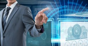 Businessman touching and interacting with technology interface panels. Digital composite of Businessman touching and interacting with technology interface panels Royalty Free Stock Photos
