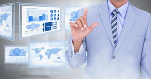 Businessman touching and interacting with technology interface panels. Digital composite of Businessman touching and interacting with technology interface panels Stock Photography