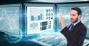 Businessman touching and interacting with technology interface panels. Digital composite of Businessman touching and interacting with technology interface panels Stock Photos
