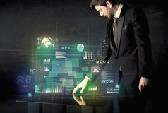 Businessman touching interactive modern desk with technology icons royalty free stock photo