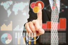 Businessman touching interface of touchscreen Stock Photos