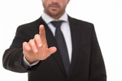 Businessman touching an invisible screen Stock Photo