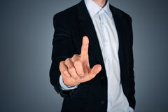 Businessman touching invisible screen Stock Images