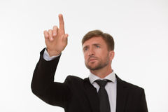 Businessman touching an invisible screen Royalty Free Stock Photo