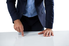 Businessman touching invisible screen on wooden table Stock Photography