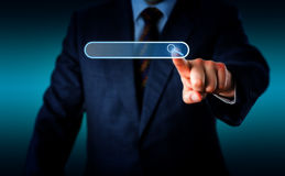 Businessman Touching Magnifier Icon In Search Box Royalty Free Stock Images