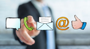 Businessman touching manuscript contact icon with his finger Royalty Free Stock Photo
