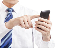 Businessman touching the mobile  phone Royalty Free Stock Photography
