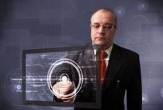 Businessman touching modern technology tablet Royalty Free Stock Image