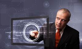 Businessman touching modern technology tablet Stock Image