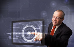 Businessman touching modern technology tablet Stock Photos