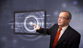Businessman touching modern technology tablet Royalty Free Stock Images