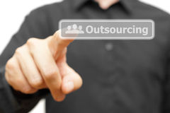Businessman touching Outsourcing word Royalty Free Stock Image