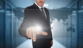 Businessman touching panel with world map on background Royalty Free Stock Photography