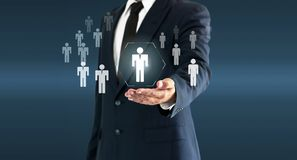 Businessman touching person virtual button about the concept of recruiting person and Personal development stock photo