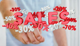 Businessman touching sales icons with his finger 3D rendering Stock Photo