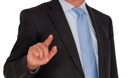 Businessman touching screen Stock Images