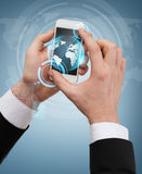 Businessman touching screen of smartphone. Business, internet and technology concept - businessman touching screen of smartphone with globe hologram on it Royalty Free Stock Image